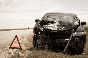 accident car and warning triangle on roadside